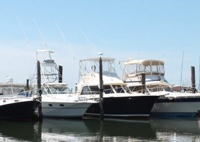 Boats in Ponquogue Marine Basin: Hatteras, Chris Craft