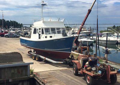 BHM 31 fishing boat on trailer in Ponquogue Marine boat yard