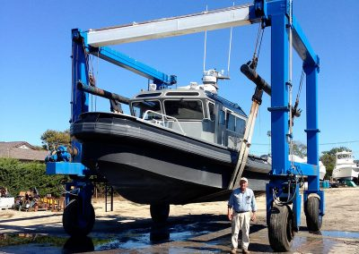 Bill Stubelek Sr. stands in front of a Wing Craft hauled for service in our Ponquogue Marine Boat Yard